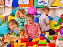 Group kids game blocks on floor Stock Photo
