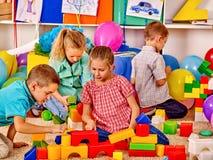 Group kids game blocks on floor Stock Photo