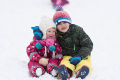 Group of kids having fun and play together in fresh snow Stock Photography