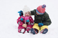 Group of kids having fun and play together in fresh snow Royalty Free Stock Photo