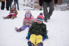 Group of kids having fun and play together in fresh snow Royalty Free Stock Image
