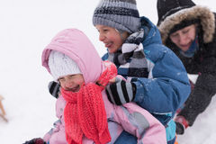 Group of kids having fun and play together in fresh snow Royalty Free Stock Photos