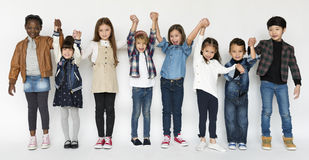 Group of Kids Holding Hands Face Expression Happiness Smiling on stock image