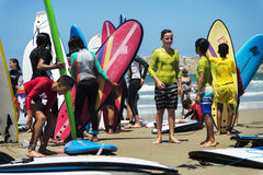 Group of kids holding surfboard on the beach Royalty Free Stock Photography