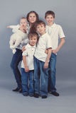 Group of kids in jeans on gray backgroud Stock Image