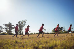 Group of kids jogging in the boot camp Royalty Free Stock Photo