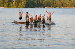 Group of kids jumping into Lake stock photography