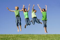 Group of kids jumping at summer camp royalty free stock images