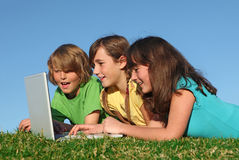 Group of kids with laptop Royalty Free Stock Photography