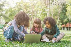 Group of kids with laptop. happy children in nature with group of friend. stock images