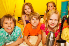 Group of kids lay in the tent Royalty Free Stock Photo