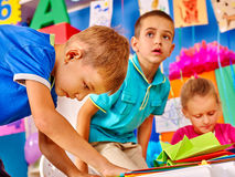 Group kids learn do origami airplane in kindergarten . Royalty Free Stock Photo