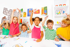 Group of kids learn first letters in reading class Stock Photography