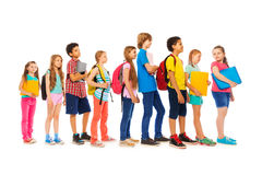 Group of kids in a line side view Royalty Free Stock Photos