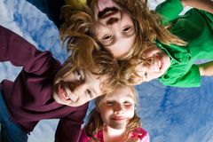 Group of kids looking down Royalty Free Stock Photo