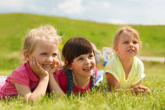 Group of kids lying on blanket or cover outdoors Royalty Free Stock Photography