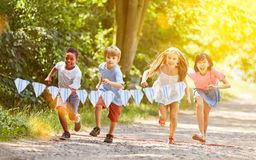 Group of kids makes race competition. In summer in the garden royalty free stock images