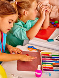 Group kids mold from plasticine  in kindergarten . Royalty Free Stock Photography