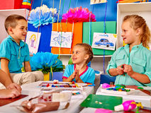 Group kids mold from plasticine  in kindergarten . Royalty Free Stock Photo