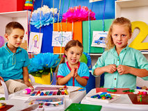 Group kids mold from plasticine  in kindergarten . Stock Photography