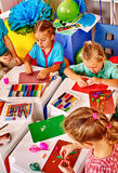 Group kids molded of plasticine table in Stock Image