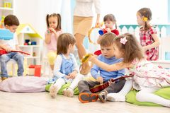 Group of kids with musical instruments in daycare