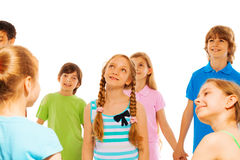 Group of kids and mysterious girl in center Royalty Free Stock Image