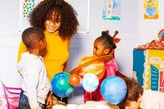 Group of kids in nursery school play learn planet royalty free stock image