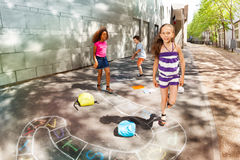 Group of kids play hopscotch near school Royalty Free Stock Photos