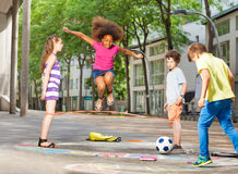 Group of kids play hopscotch on the school Stock Photography