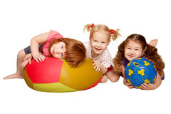 Group of kids playing with balls. Group of kids lying and playing with balls. Isolated on white background stock image