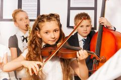 Group of kids playing musical instruments together Royalty Free Stock Photos