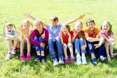 Kids outside in park. Group of kids playing outside in a park stock photography