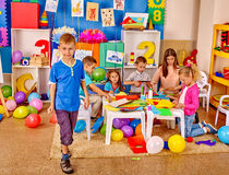 Group kids in preschool interior Stock Photos