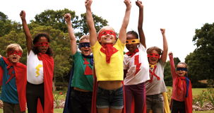 Group of kids pretending to be a super hero. In the park 4k stock footage