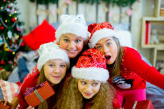 Group of kids in red hat with Christmas gifts Stock Image