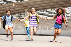 Group of kids run holding hands and screaming Royalty Free Stock Photography