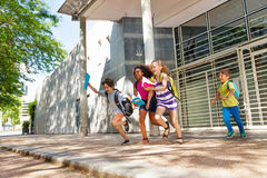 Group of kids run from the school Stock Image
