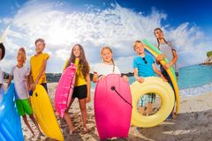 Group of kids in seashore with swimming equipment Stock Photography