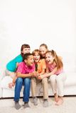 Group of kids singing on sofa Royalty Free Stock Photos