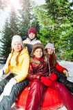 Group of kids sitting on the sledge in park Stock Photo