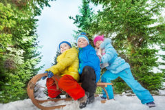 Group of kids slide down the hill on sledge Royalty Free Stock Photos