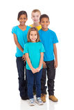 Group of kids. Group of smiling kids standing together on white background Stock Images