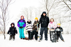 Group of kids in the snow with sleds Royalty Free Stock Images