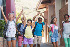 Group of kids standing in a row at school campus stock photos