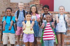 Group of kids standing on staircase showing thumbs up Royalty Free Stock Photography