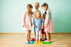 Group of kids stands on massaging mats stock photography