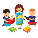 Group of kids studying and learning together Stock Images