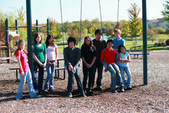 Group of kids on swingset. Diverse group of multi-ethnic kids on swingset Royalty Free Stock Images