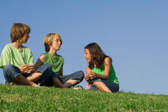 Group of kids talking Stock Photos